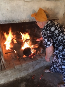Daji heats cooking pots